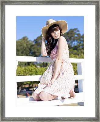 Portrait Of A Smiling Woman Resting On A Pier Bench Framed Print by Jorgo Photography - Wall Art Gallery