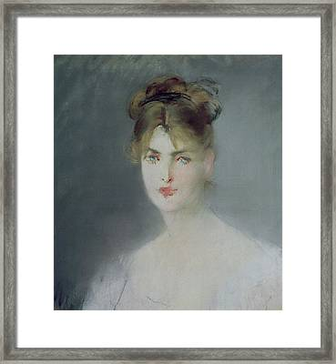 Portrait Of A Young Woman With Blonde Hair And Blue Eyes Framed Print