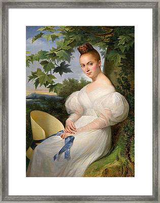Portrait Of A Young Woman With Straw Hat Framed Print