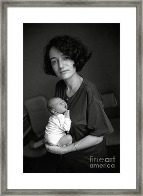 Portrait Of Mature Woman With Newborn Baby Framed Print