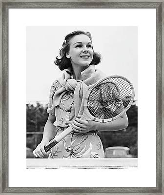 Portrait Of Woman With Racquet On Tennis Court Framed Print by George Marks