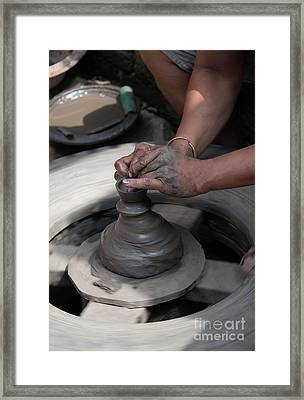 Potters Hands Crafting A Clay Ceramic Pot Framed Print