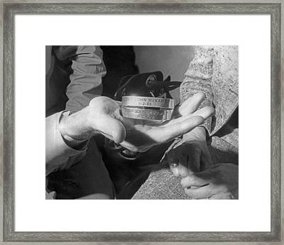 Pow Bracelets Framed Print by Underwood Archives