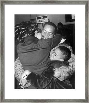 Pow Greets Family Framed Print by Underwood Archives