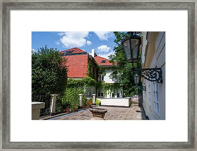 Framed Print featuring the photograph Prague Courtyards. Old Lantern by Jenny Rainbow