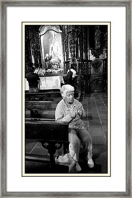 Praying Framed Print by Daniel Gomez