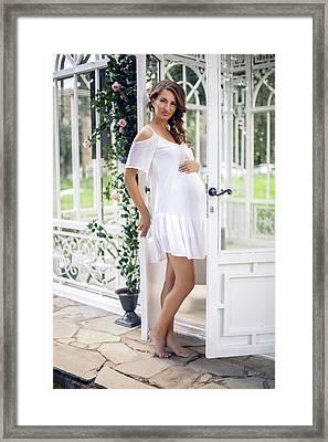 Pregnant Girl In A White Dress On The Street Framed Print