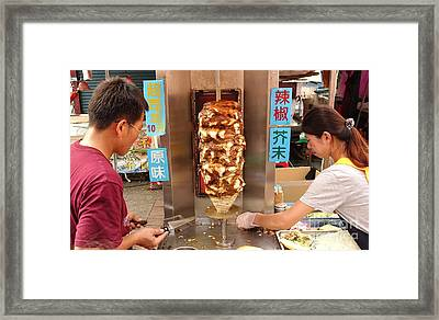 Framed Print featuring the photograph Preparing Shawarma Meat In Bread Buns by Yali Shi