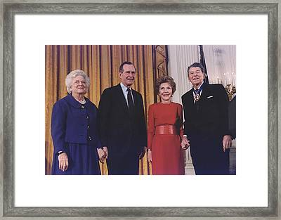 President George Bush Presents Framed Print by Everett