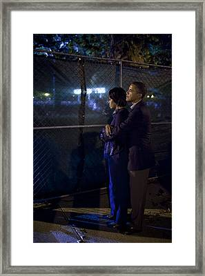 President Obama Embraces Michelle Framed Print by Everett