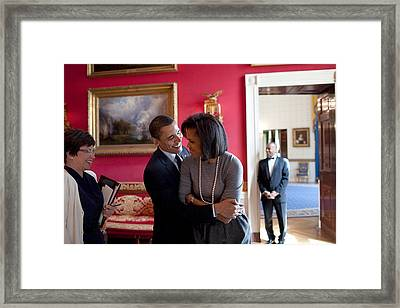 President Obama Hugs First Lady Framed Print by Everett