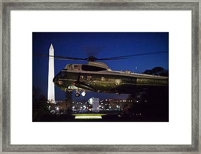 President Obama Reading As Marine One Framed Print by Everett