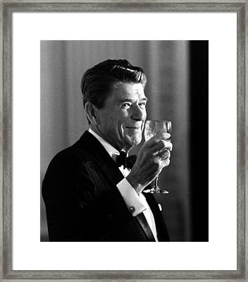 President Reagan Making A Toast Framed Print