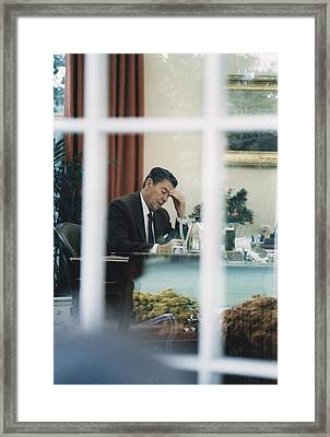 President Reagan Working In The Oval Framed Print by Everett
