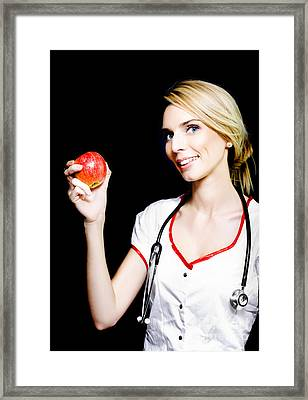 Pretty Nurse Shows The Benefits Of Eating Properly Framed Print by Jorgo Photography - Wall Art Gallery