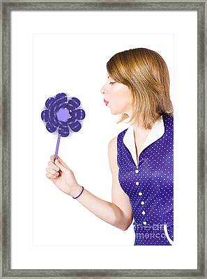 Pretty Pin Up Girl Playing With Purple Pinwheel Framed Print