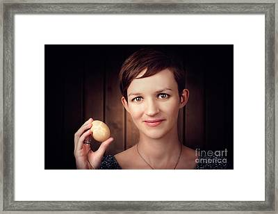 Pretty Young Brunette Woman Holding Hatching Egg Framed Print