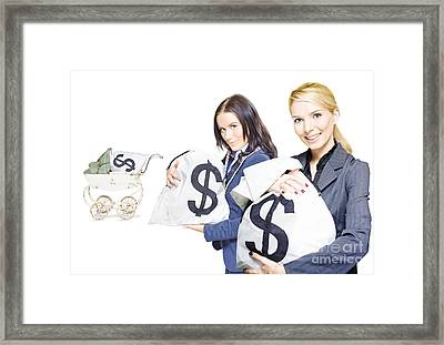 Pretty Young Business Women Holding Sacks Of Money Framed Print by Jorgo Photography - Wall Art Gallery