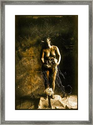 Primitive Woman Holding Mask Framed Print