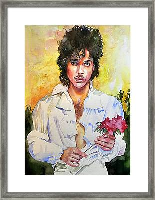 Prince Rogers Nelson Holding A Rose Framed Print