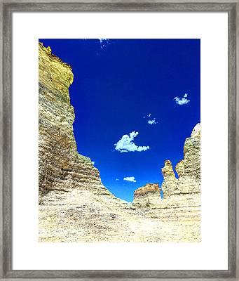 Pristine Sky Meets Historic Rocks Framed Print