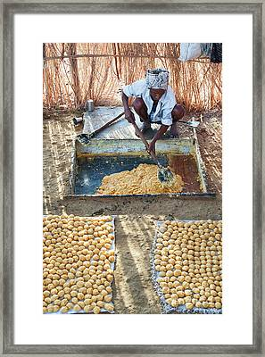 Producing Jaggery Framed Print by Tim Gainey