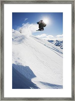 Professional Snowboarder Making A Jump Framed Print by Dean Blotto Gray