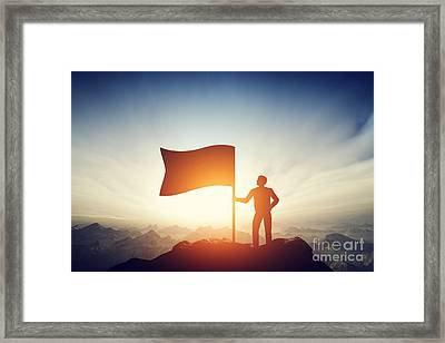 Proud Man Raising A Flag On The Peak Of The Mountain. Challenge, Achievement Framed Print