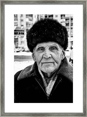 Proud Russian Old Man With Fur Hat In Winter Framed Print