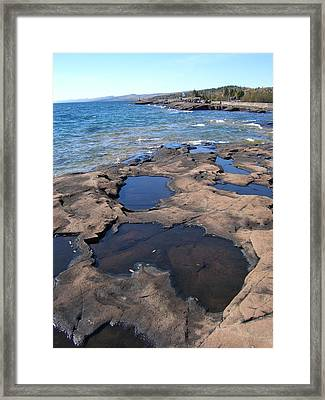 Puddles Framed Print by Jessica Yudis