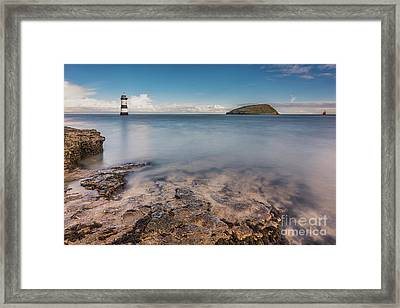 Puffin Island Lighthouse  Framed Print by Adrian Evans