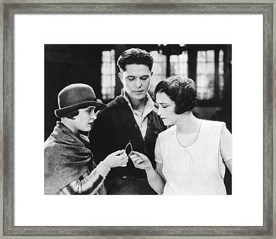 Pulling On A Wishbone Framed Print
