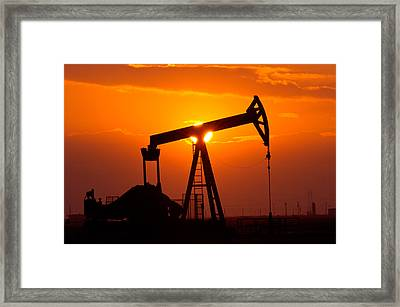 Pumping Oil Rig At Sunset Framed Print