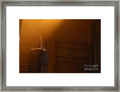 Punching Bag In The Light Framed Print by Micah May