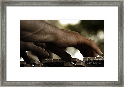 Pushing Sound Framed Print by Steven Digman
