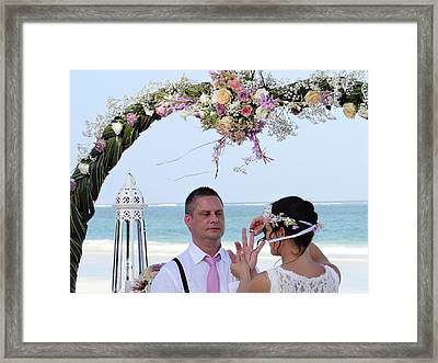 Putting On The Ring Framed Print