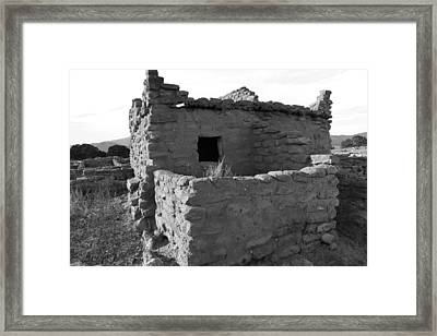 Puye Cliff Ruins Framed Print by Jeff Swan