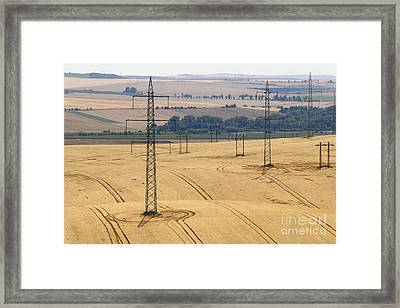 Pylons In The Fields Framed Print