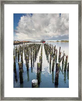 Framed Print featuring the photograph Pylons To The Ship by Greg Nyquist