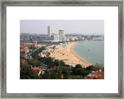 Qingdao Beach With Skyline Framed Print by Carol Groenen