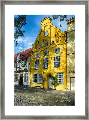 Quaint Yellow House In Old Town Lubeck Framed Print