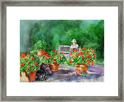 Quiet Moment Reading In The Garden Framed Print by Irina Sztukowski