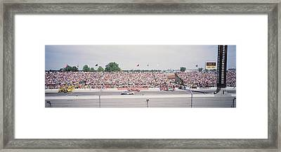 Racecars On A Motor Racing Track Framed Print