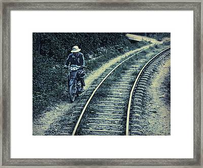 Racing The Train Framed Print by Claude LeTien
