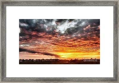 Raging Sunset Framed Print
