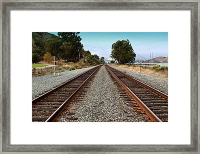 Railroad Tracks With The New Alfred Zampa Memorial Bridge And The Old Carquinez Bridge In Distance Framed Print by Wingsdomain Art and Photography