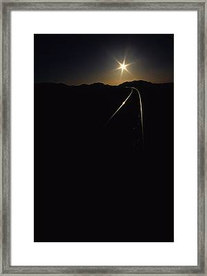 Rails At Sunrise Framed Print by Susan  Benson