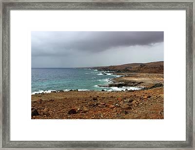 Rain Clouds Brewing Off The Coast Of Island Of Aruba Framed Print by Design Turnpike
