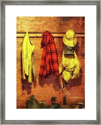 Rain Gear And Red Plaid Jacket Framed Print by Susan Savad