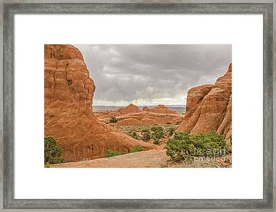Framed Print featuring the photograph Rain In The Distance At Arches by Sue Smith